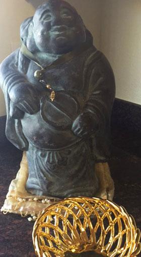 280 Buddha and gold bowl